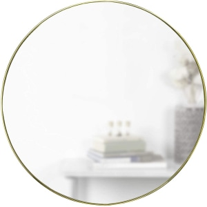 specchio-tondo-parete-letto